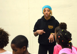 Ithaca College senior Harmony Graves works with the GIAC Navigators youth track team.