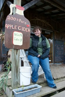 Ithaca student Sarah Hine '12 outside the shop at Littletree Orchards.
