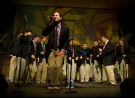 Ithacappella performs onstage