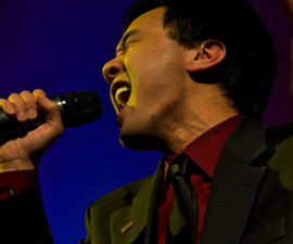 Ithacappella's Nate Tao '10 performs at Emerson Suites. Photo by Mike Grippi '10