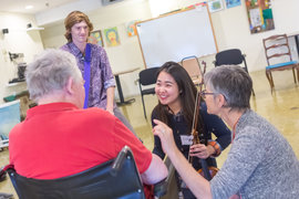 Jane assists students in music as medicine