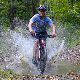 Jason Sibley-Liddle '10 rides the trails in the Shindagin Hollow State Forest. Photo by Jeff Goodwin '10