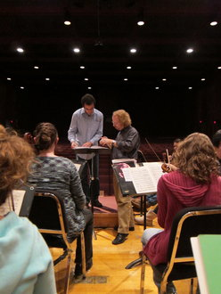 Jeffery Meyer works with a graduate conductor