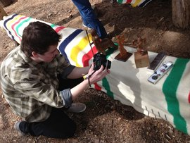 Junior Taylor Graham examines Native American crafts