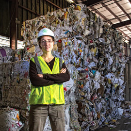 Kat McCarthy '05 in front of trash block