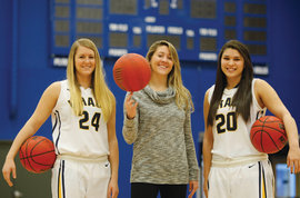 Kathryn Campbell �13, Katherine Bixby �10, and Jenn Escobido �14 have each scored 1,000 points in their IC basketball careers.