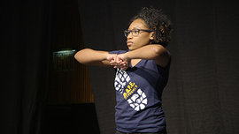 Kayla Brathwaite '19 stands in formation between moves. Photo by Giovanni Santacroce.