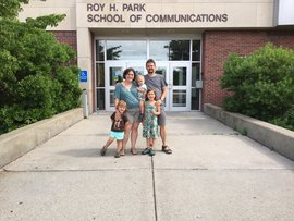 Kinch and her family in front of Roy H. Park School of Communications.
