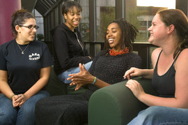 LGBT activist and artist Lenelle Moise talks with students during Ithaca's annual National Coming Out Day celebration.