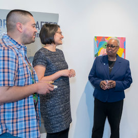 La Jerne Terry Cornish and faculty converse in an art gallery