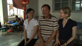 Li Zhen, Cotton Road's co-producer, and Laura Kissel sit with a clothing factory cook in China