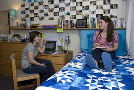 Lindsay Harrop '13 and Kim Reitas '13 catch up on funny stories in their dorm room in Rowland. Photo by Daniel Sitts
