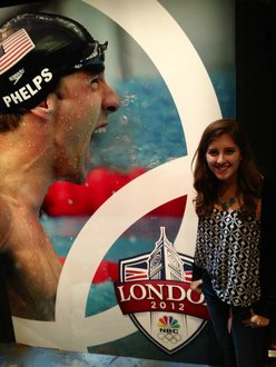 Lindsey Smith '14 posing with Michael Phelps inside the Highlights Factory