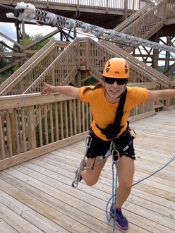 Maddy in Zip lining gear on the deck of the cloudsplitter line