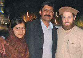 Malala Yousafzai, her father, Zia, and Adam Ellick '99