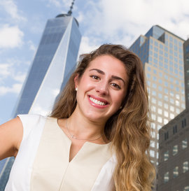 Maria Behrens standing in front of a NYC skyscape
