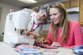 Mary Claire Hartford '15 learns to use a sewing machine at a meeting of the Longview Quilting Club.