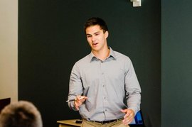 Me presenting in front of a small group at an economics conference in Atlanta, Georgia.