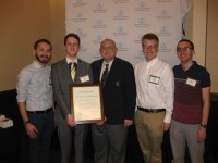 "Members of ""The Ithacan"" accept the Gold Crown award from the Columbia Scholastic Press Association."