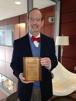 "Michael LaTour with the Best Article of the Year award from the ""Journal of Advertising."""