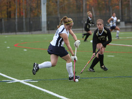 Midfielder JulieAnne Butare '12 charges the Bombers newest playing field.