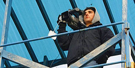 Mike Puleo '09 works as a videographer for the football team.