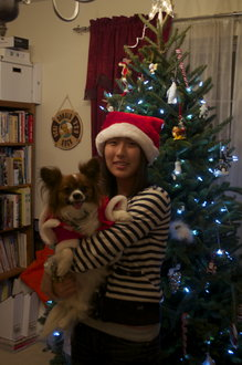 My dog and me in front of the tree