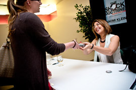 Naomi Klein signs copies of her book, The Shock Doctrine.     Photo by Allison Usavage '12.