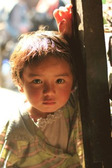 Near the Chinese border in Nepal, a young Tibetan refugee connects with the camera. Photo by Kathryn Cooper '06