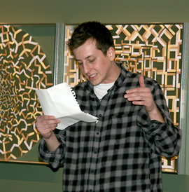 Patrick Ballester �11 gives a spirited reading during the open mic session on March 24.
