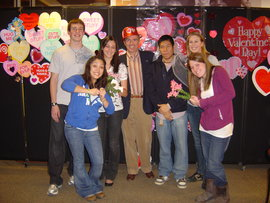 President Rochon with six IC students at Valentines Day party