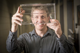 Professor Ian Wood with zebra fish