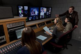 Professor Peter Johanns instructs students in one of our television studio control rooms..