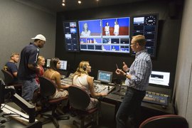 Professor Peter Johanns works with students in one of our television studio control rooms.