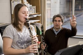 Professor Rick Faria and student rehearse in his studio.