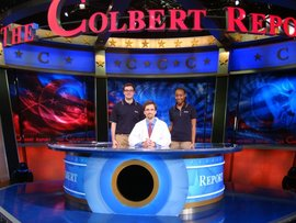 "Professor Sullivan with students Andrew Hope and Jodi McLean on the set of the ""Colbert Report."""