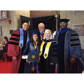Professors Arliss, Brown, House, Sullivan, pose for a photo with 2016 graduate Sandra Rojas