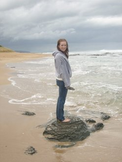Rebecca standing on a beach in Australia
