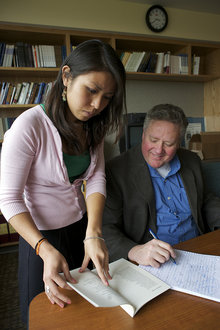 Reina Argueza '10 works with Split Oak founder and writing professor Jim Stafford
