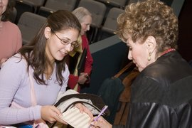 Renowned opera star Roberta Peters signs autographs for students after her performance and master class in Ford Hall.