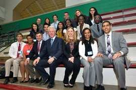 Robert Harrison, former President Clinton and Chelsea Clinton sitting with IMC's Jablonski and the Cornell constituency