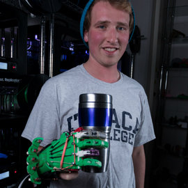 Ryan Bouricius with his 3D-printed prosthetic hand