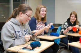 Sabina Leybold '17 (center) shares a laugh with other members of IC's Project Sunshine. Photo by Joshua Glass '19.