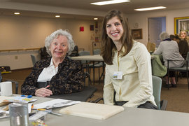 Sara Fisher '14 works with a client at IC's Center for Life Skills. Photo by Jacob Beil '15