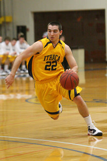 Sean Rossi '13 makes a drive for the hoop.