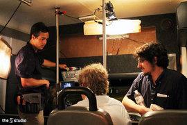 """Sebastian Allen '17 and Daniel Masciari '15 film """"No Fare"""" on a bus."""