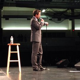 Seth Meyers on stage at Ithaca College's Athletics and Events Center.