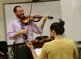 String Music Ed Professor James Mick teaches a student