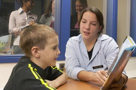 Students conduct and observe a speech therapy session.