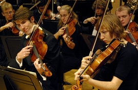 Students in the Ithaca College Orchestra perform.